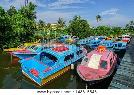 Colourful taxi speedboats Menumbok to Labuan island at Menumbok terminal.It is a passenger taxi service operator & tourist attraction to Labuan Pearl Of Borneo.