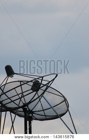 Satellite dish antenna isolated on sky background