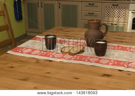 Still life with pottery milk and bread in the kitchen in the countryside