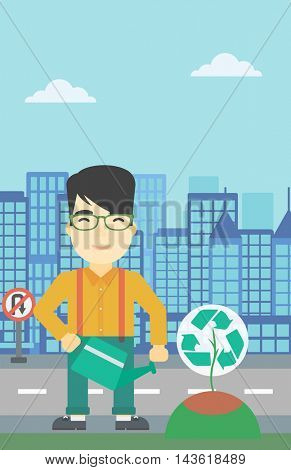 An asian young man watering a tree with a recycle sign instead of crown on a city backround. Eco-friendly man takes care of the environment. Vector flat design illustration. Vertical layout.
