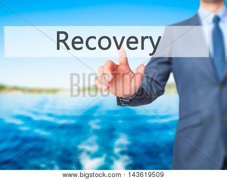 Recovery - Businessman Hand Pressing Button On Touch Screen Interface.