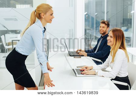 Businesswoman lecture to his colleagues at presentation in the conference room
