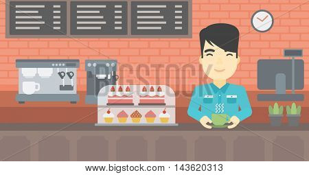 An asian young man standing at the counter with cup of coffee on the background of bakery with pastry and coffee maker. Man making coffee. Vector flat design illustration. Horizontal layout.