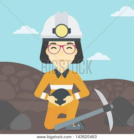 An asian female miner  in hard hat sitting with coal in hands and a pickaxe on the background of coal mine. Vector flat design illustration. Square layout.