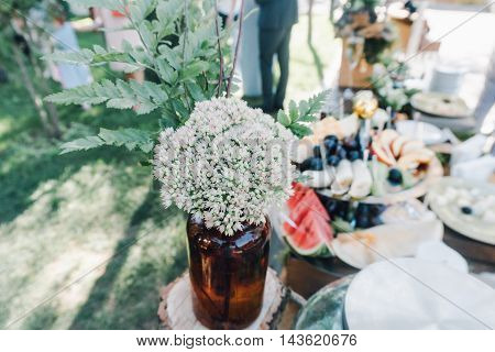Designer wedding design styles, boho, floral bouquets, wreaths of flowers and wooden lanterns