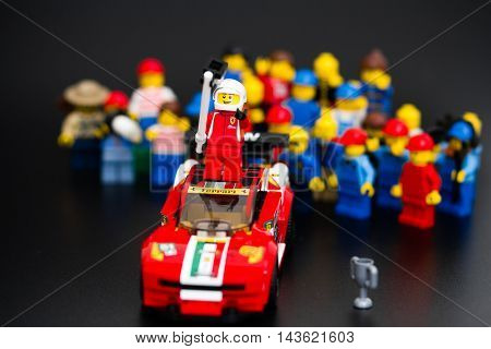 Orvieto Italy - January 17th 2015: . Lego minifigure driver of Ferrari racing car take a selfie with with their fans. Lego is a popular line of construction toys manufactured by the Lego Group