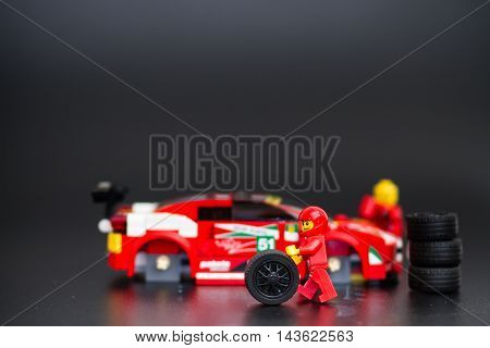 Orvieto Italy - January 17th 2015: . Lego minifigure mechanic of Ferrari Racing Team. Lego is a popular line of construction toys manufactured by the Lego Group