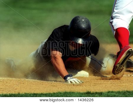 Baseball Player Sliding Into A Base