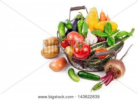 Fresh vegetable harvest in basket from leaf basil. Isolated on white background
