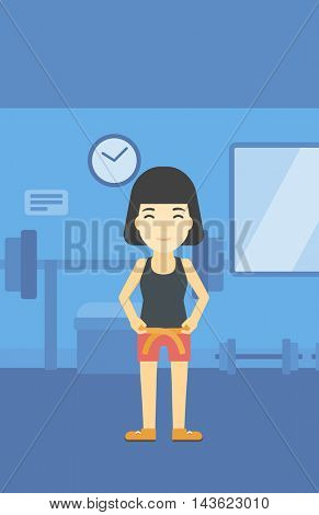 An asian young woman measuring his waistline with a tape in the gym. Woman measuring with tape the abdomen. Woman with centimeter on a waist. Vector flat design illustration. Vertical layout.