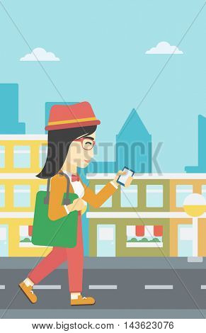An asian young woman walking with smartphone and handbag. Woman using smartphone in the city street. Smartphone addiction. Vector flat design illustration. Vertical layout.