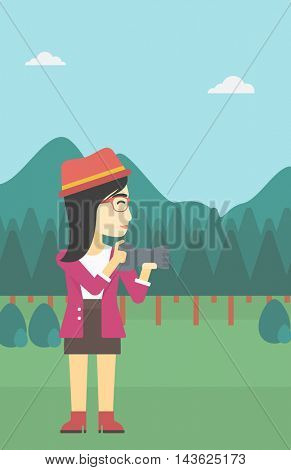 An asian young woman taking a photo of landscape. Photographer taking a picture in the mountains. Nature photographer with digital camera. Vector flat design illustration. Vertical layout.