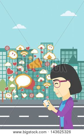 An asian woman using smartphone with lots of social media application icons flying out on a city background. Vector flat design illustration. Vertical layout.