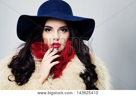 Young Woman with Brown Hair and blue hat