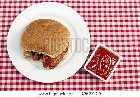 Sausage sandwich A traditional British sausage sandwich in a bun