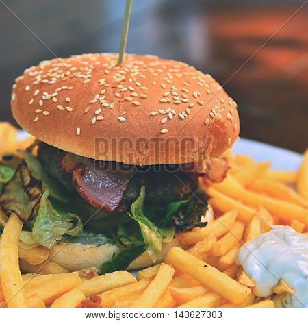 Hamburger with fries. Favorite unhealthy food from fast food.