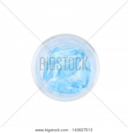Shot glass full of blue softgel medical pills isolated over the white background