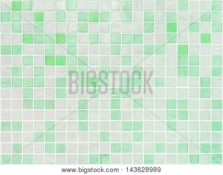 Closeup surface tiles pattern at green tiles in bathroom wall texture background