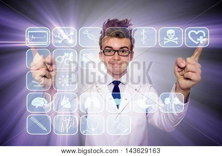 Man doctor pressing buttons with various medical icons