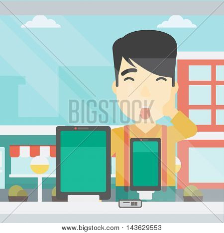 Astonished man looking at digital tablet and smartphone through the shop window. An asian young man with open mouth looking at tablet and phone. Vector flat design illustration. Square layout.