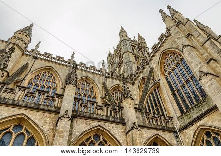 Facade of tower in Bath Abbey in Bath, England in daylight.