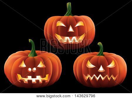 Three halloween pumpkins with carved faces isolated on a plain background.