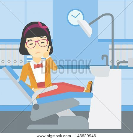 An asian young female patient sitting in dental chair at dentist office. Sad woman suffering from tooth pain. Woman having a toothache. Vector flat design illustration. Square layout.