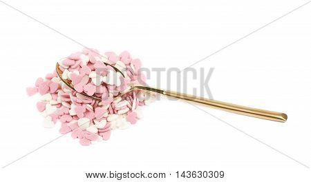 Spoon full of sugar heart shaped sprinkles isolated over the white background