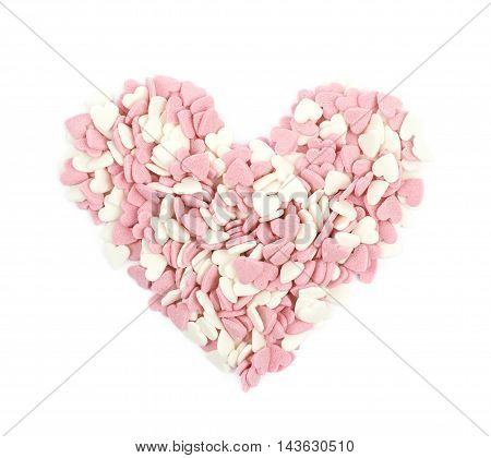 Heart shape made of pink sugar sprinkles isolated over the white background