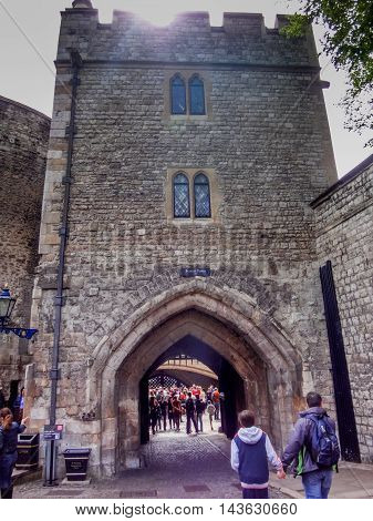 Father and son hold hands while touring the Tower of London