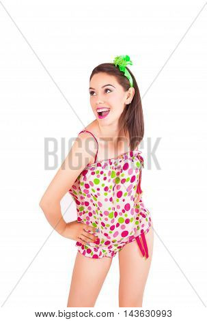 Portrait of pretty young brunette woman in colorful pajamas in the studio isolated on a white background
