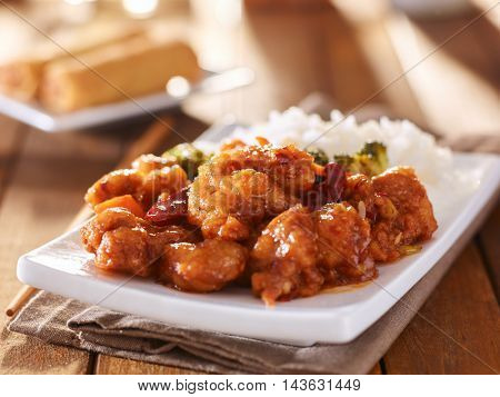plate of chinese general tsos chicken with rice and broccoli