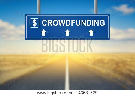 crowdfunding words on blue road sign with blurred background