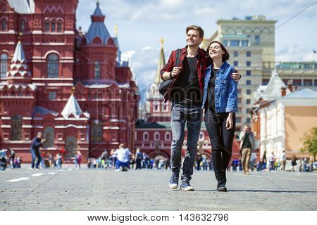 Happy tourists sightseeing city. Red Square, Moscow, Russia