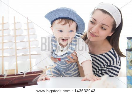 Travel Concept. Mother And Son Playing With The Ship.