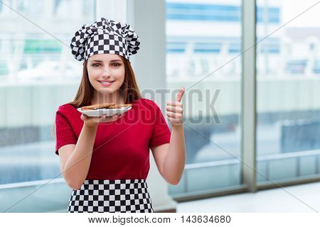 Young cook preparing cookies in the kitchen