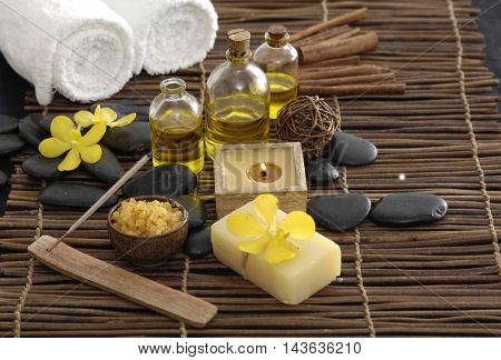Spa setting with orchid, stones,candle,mat
