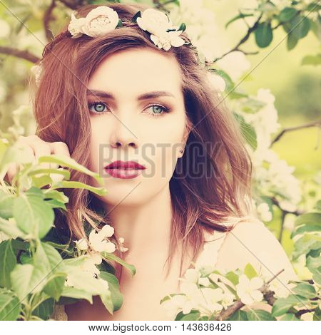 Magnificent Woman with Spring Blossom Background. Girl Outdoors