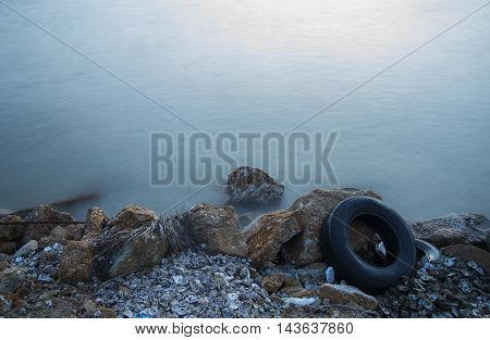Garbage, plastic, wood,shell and  wheel on the beach
