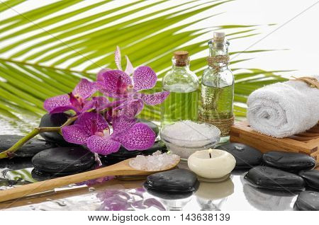 Spa Background with green palm with orchid,towel