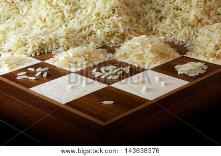 chessboard with growing heaps of rice grains legend about the exponential function and unlimited growth selected focus narrow depth of field