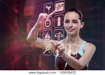 Young girl in sports concept pressing virtual buttons