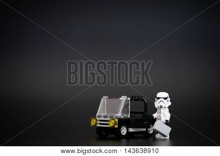 Orvieto, Italy - November 22th 2015: Star Wars Lego Stormtroopers minifigures on car. Going to work. Lego is a popular line of construction toys manufactured by the Lego Group