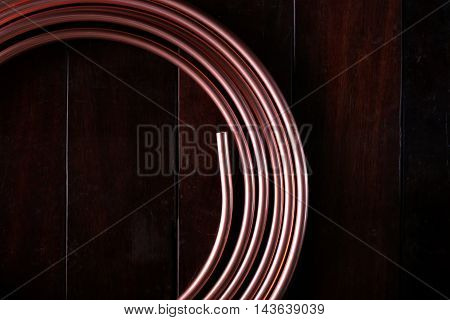 Coiled copper tube circle on the wood