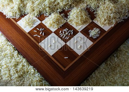 chessboard with growing heaps of rice grains view from above showing the exponential function and unlimited growth selected focus
