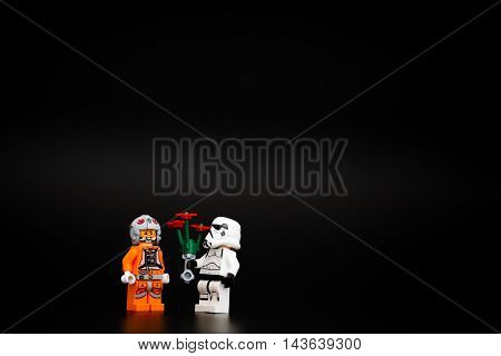 Orvieto Italy - November 15th 2015: Star Wars Lego Stormtroopers minifigures gives flowers to the enemy as a sign of peace. Lego is a popular line of construction toys manufactured by the Lego Group