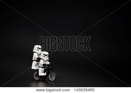 Orvieto Italy - November 15th 2015: Star Wars Lego Stormtroopers minifigures on bicycle. Lego is a popular line of construction toys manufactured by the Lego Group