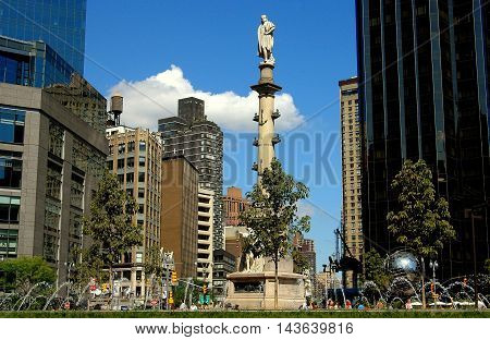 New York City - September 3 2004: View of Broadway looking north from Columbus Circle with fountains and Christopher Columbus memorial column