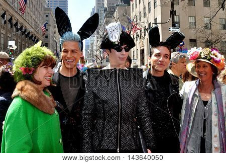New York City - April 20 2014: Group of friends in original holiday creations and bunny ears at the Easter Parade on Fifth Avenue