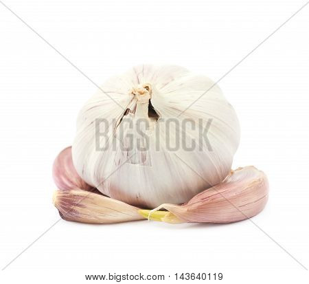 Pile of garlic bulb and cloves isolated over the white background